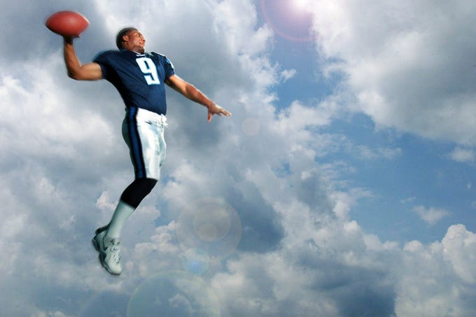 Tennessee Titans quarterback Steve McNair, showing off his passing form Aug. 21, 2000, is ready for a new season after coming up inches short in Super Bowl XXXIV.