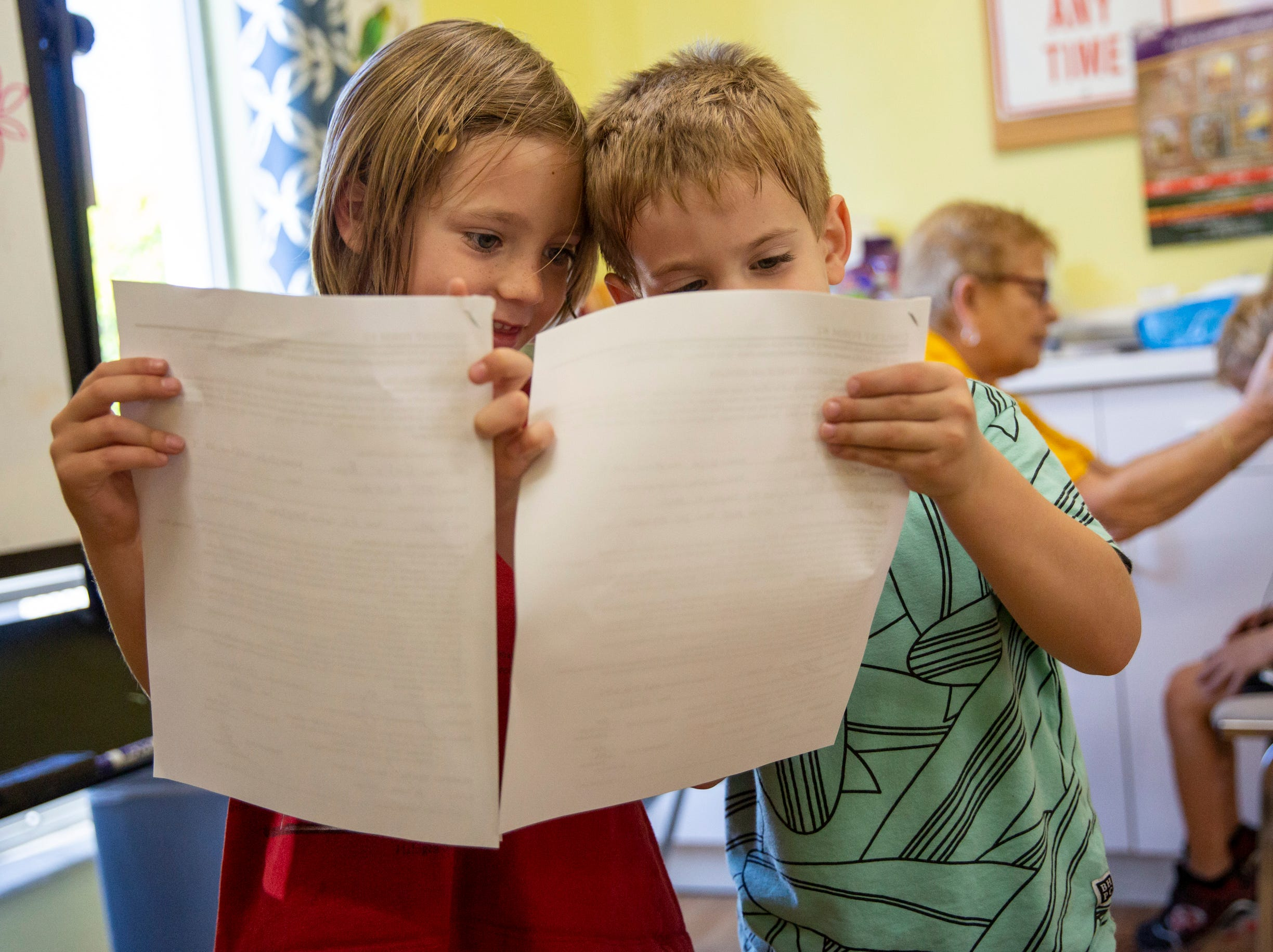 Colin Ryan, 4, left, and Walker Barberio, 4, right, compare their forms at Grace Lutheran Preschool in Naples on Friday, April 12, 2019.