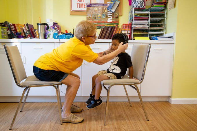 Volunteer Merry Hovey helps Quincy Patton, 3, put on headphones to test his hearing at Grace Lutheran Preschool in Naples on Friday, April 12, 2019. The Naples Lions Club, with the help of the Naples Nites Lions Club and the Marco Island Lions Club, screens vision and hearing for over 2,000 preschool children annually.