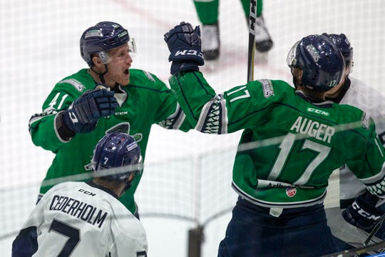 Florida Everblades' Blake Winiecki (41) celebrates with Justin Auger (17) after Auger scored the first goal against the Jacksonville Icemen, Thursday at Hertz Arena in Estero.