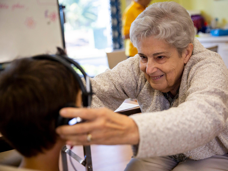 Volunteer Pat Kienlen puts headphones on Max Gabriel, 4, so she can test his hearing at Grace Lutheran Preschool in Naples on Friday, April 12, 2019.