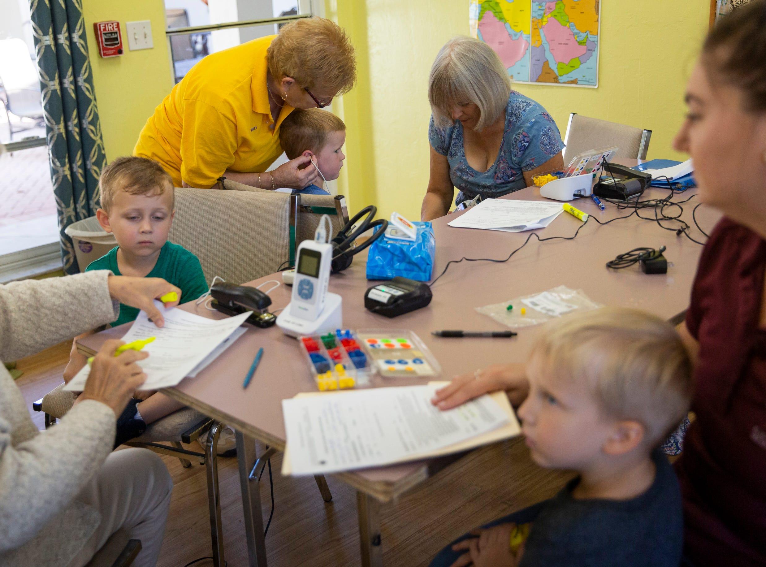 Naples Lions Club volunteers test preschoolers' hearing at Grace Lutheran Preschool in Naples on Friday, April 12, 2019.