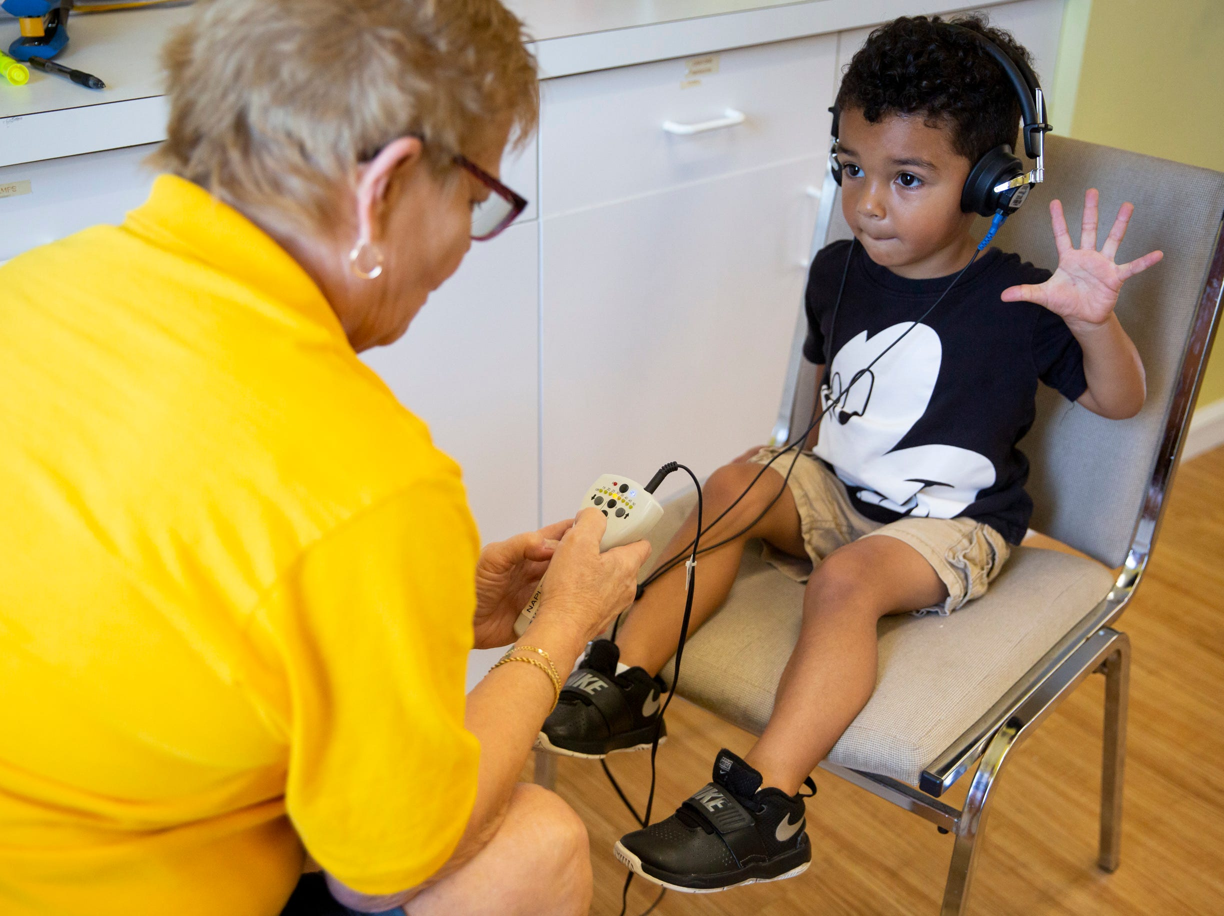 Volunteer Merry Hovey tests Quincy Patton's hearing at Grace Lutheran Preschool in Naples on Friday, April 12, 2019.