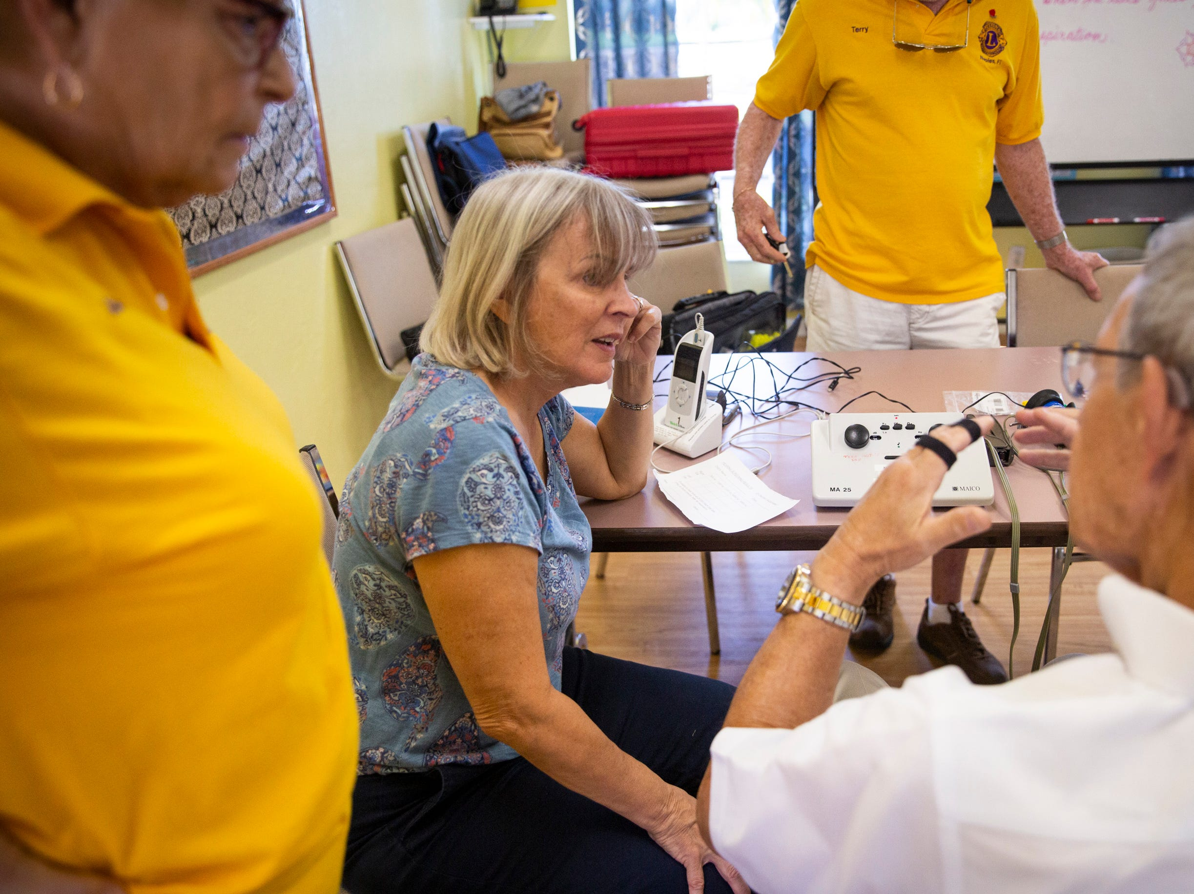 Dr. Howard Freedman, right, shows Merry Hovey, left, and Diane Leone, center, how to use a machine to test hearing at Grace Lutheran Preschool in Naples on Friday, April 12, 2019.