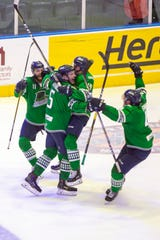 Florida Everblades celebrate after Michael Downing (5) scored the winning goal against the Jacksonville Icemen during overtime, Thursday, April 11, 2019, at Hertz Arena in Estero.