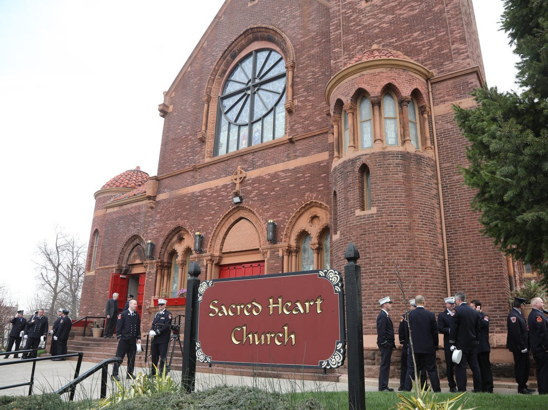 Firefighters gather before the funeral Mass for Lt.Timothy O'Neill at the Sacred Heart Church before his funeral Mass. New York City Fire Department Lt. Timothy O'Neill's funeral was held at Sacred Heart Church in Staten Island on April 12, 2019. O'Neill died of pancreatic cancer attributed to the time he spent at Ground Zero after the attacks of September 11, 2001.