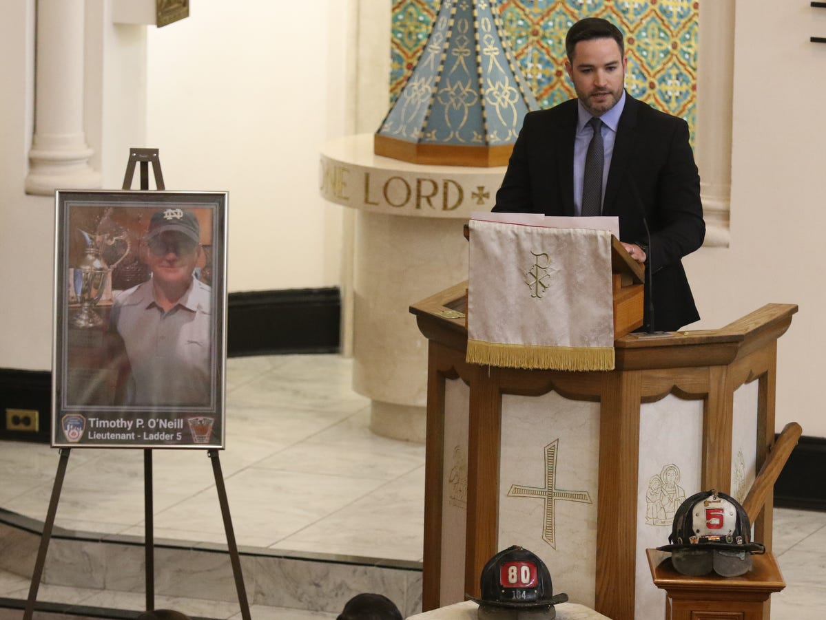 Tom O'Neill delivers his father's eulogy at Sacred Heart Church for the funeral Mass held for New York City Fire Department Lt. Timothy O'Neill's. The funeral Mass was held at Sacred Heart Church in Staten Island on April 12, 2019. O'Neill died of pancreatic cancer attributed to the time he spent at Ground Zero after the attacks of September 11, 2001.