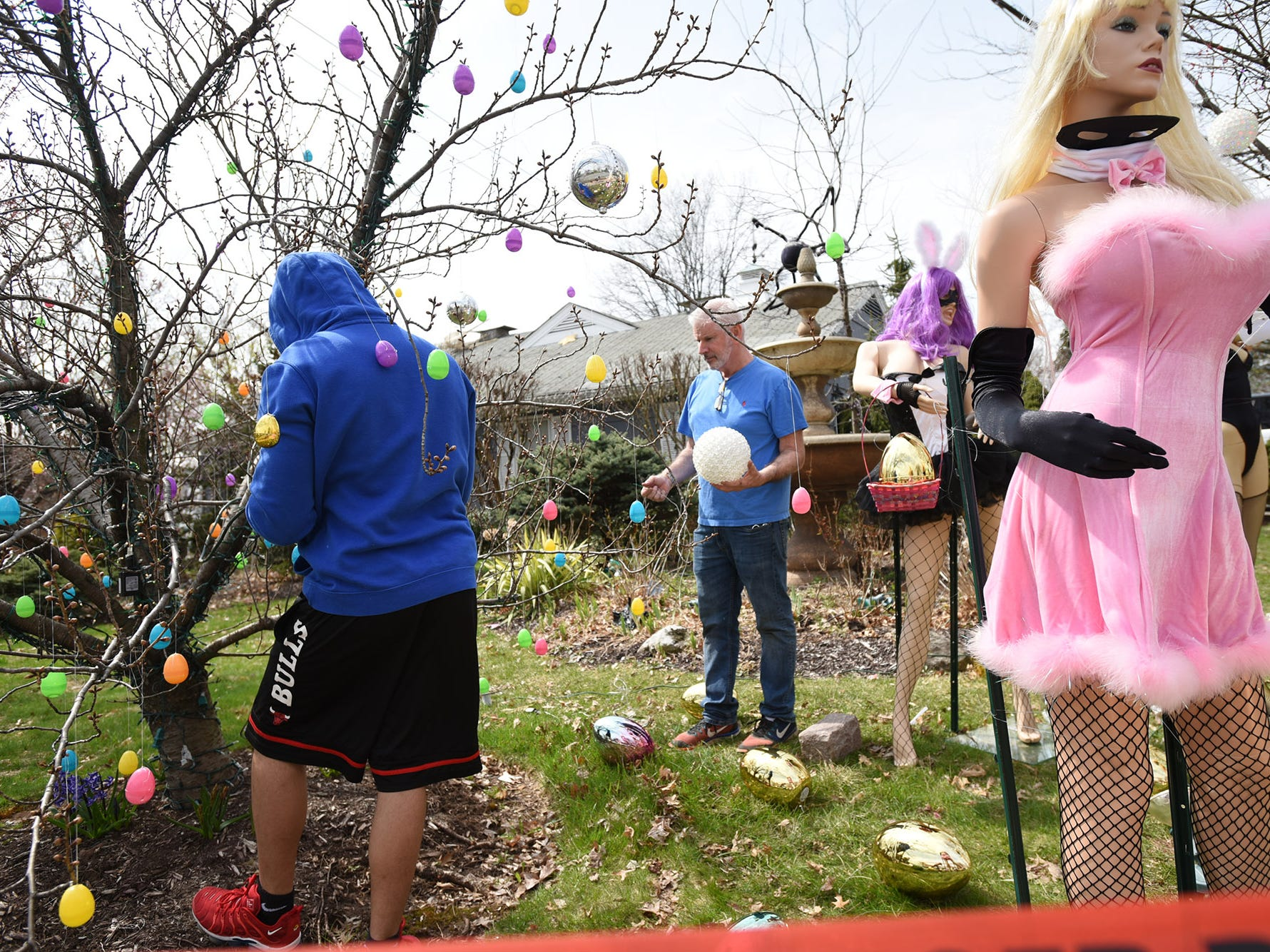 Neighbor Alex Cruz and Wayne Gangi set up an Easter display on Grove Street in Clifton on Friday April 12, 2019. The original display was dismantled by a neighbor.