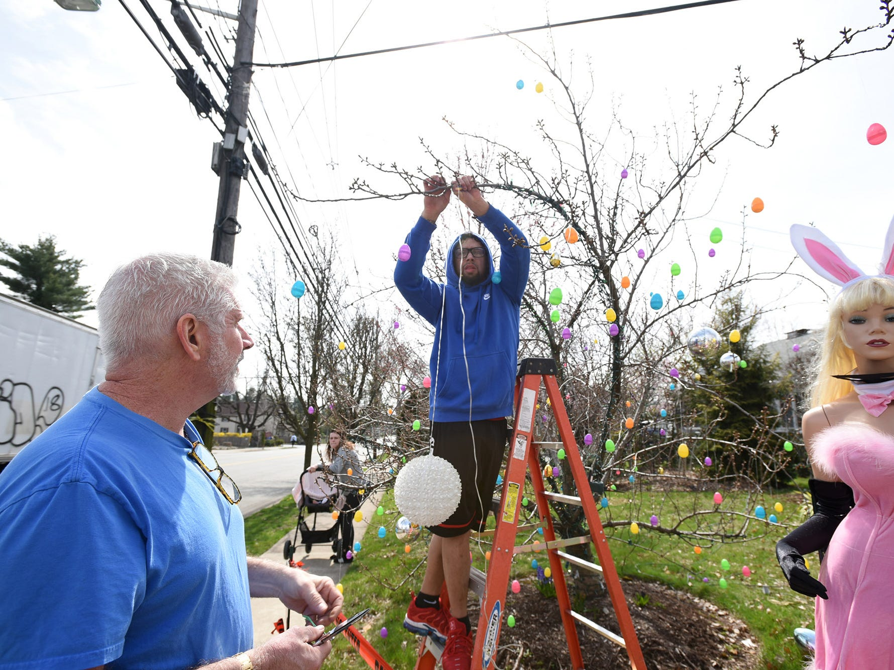 Wayne Gangi and neighbor Alex Cruz set up an Easter display on Grove Street in Clifton on Friday April 12, 2019. The original display was dismantled by a neighbor.