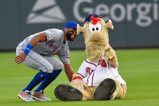 Apr 11, 2019; Atlanta, GA, USA; New York Mets shortstop Amed Rosario (1) interacts with Atlanta Braves mascot Blooper before the game at SunTrust Park.