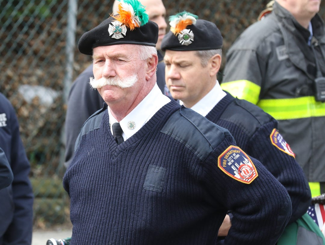 The pipe band outside the Sacred Heart Church before the funeral Mass for New York City Fire Department Lt. Timothy O'Neill's. The Mass was held at Sacred Heart Church in Staten Island on April 12, 2019. O'Neill died of pancreatic cancer attributed to the time he spent at Ground Zero after the attacks of September 11, 2001.