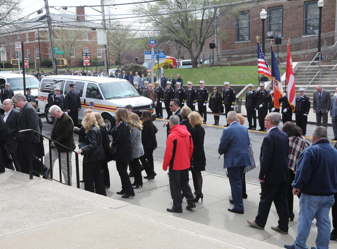 Firefighters, family and friends of Lt.Timothy O'Neill enter the Sacred Heart Church for his funeral Mass. New York City Fire Department Lt. Timothy O'Neill's funeral was held at Sacred Heart Church in Staten Island on April 12, 2019. O'Neill died of pancreatic cancer attributed to the time he spent at Ground Zero after the attacks of September 11, 2001.