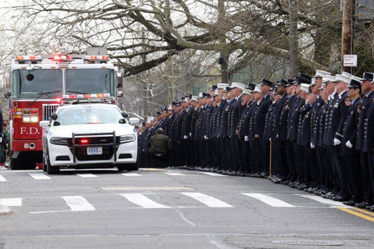 The remains of Lt.Timothy O'Neill are carried by a fire truck to the Sacred Heart Church before his funeral Mass. New York City Fire Department Lt. Timothy O'Neill's funeral was held at Sacred Heart Church in Staten Island on April 12, 2019. O'Neill died of pancreatic cancer attributed to the time he spent at Ground Zero after the attacks of September 11, 2001.