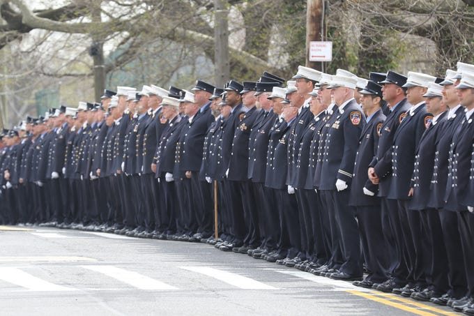 Firefighters line Castleton Ave. as the truck containing the remains of Lt.Timothy O'Neill leave the Sacred Heart Church following his funeral Mass. New York City Fire Department Lt. Timothy O'Neill's funeral was held at Sacred Heart Church in Staten Island on April 12, 2019. O'Neill died of pancreatic cancer attributed to the time he spent at Ground Zero after the attacks of September 11, 2001.