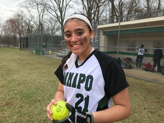 Ramapo freshman Sydney Samuel with her home run ball after the Green Raiders beat Teaneck, 13-11 on Friday.