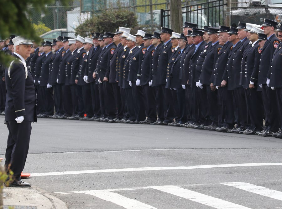 Firefighters line Castleton Ave. as the truck containing the remains of Lt.Timothy O'Neill head to Sacred Heart Church for his funeral Mass. New York City Fire Department Lt. Timothy O'Neill's funeral was held at Sacred Heart Church in Staten Island on April 12, 2019. O'Neill died of pancreatic cancer attributed to the time he spent at Ground Zero after the attacks of September 11, 2001.
