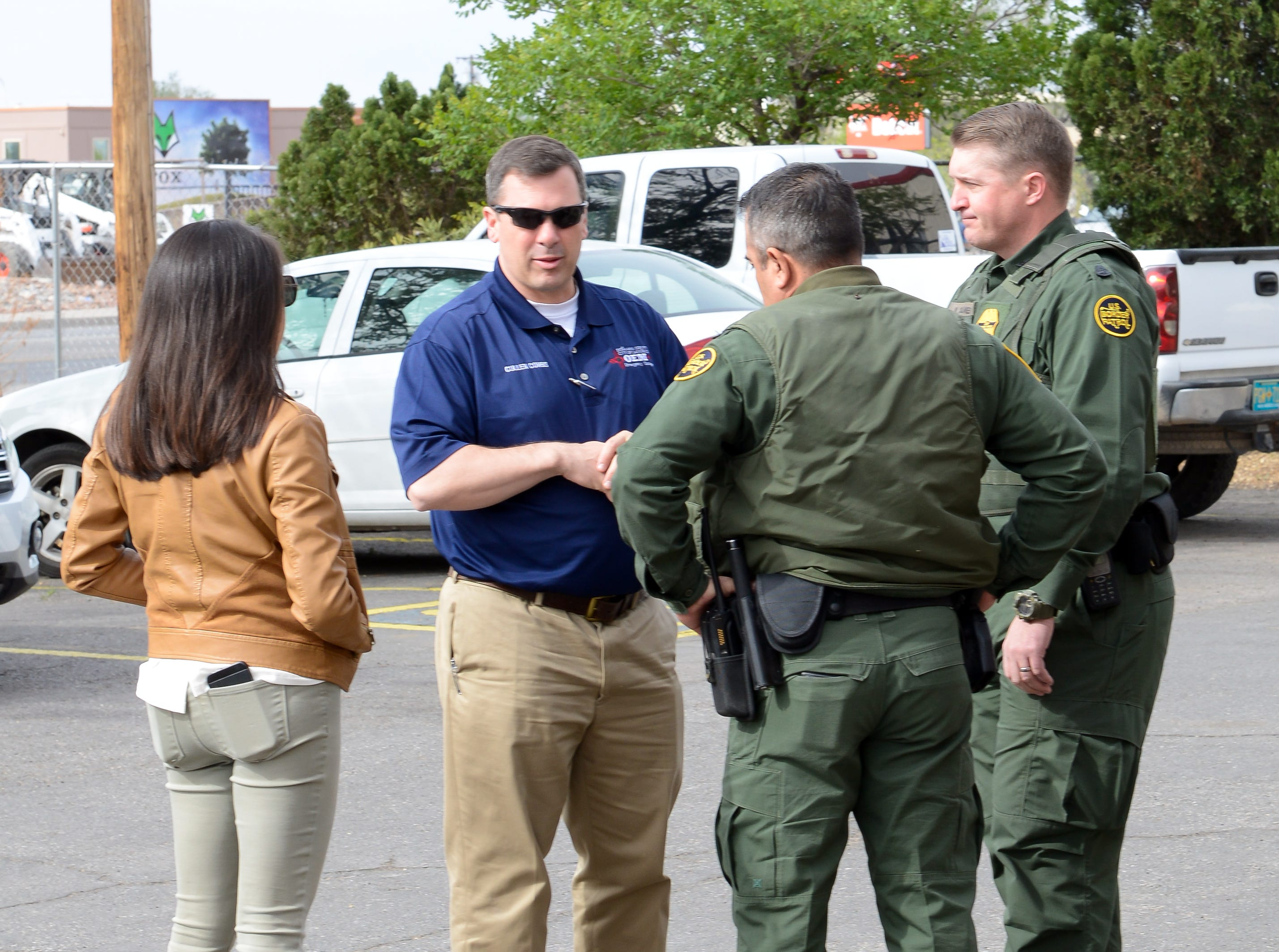 Cullen Combs, emergency manager for Las Cruces and Doña Ana County, speaks to Border Patrol agents and Claudia Tristán, bilingual press secretary for Gov. Michelle Lujan Grisham in Las Cruces on Friday, April 12, 2019.
