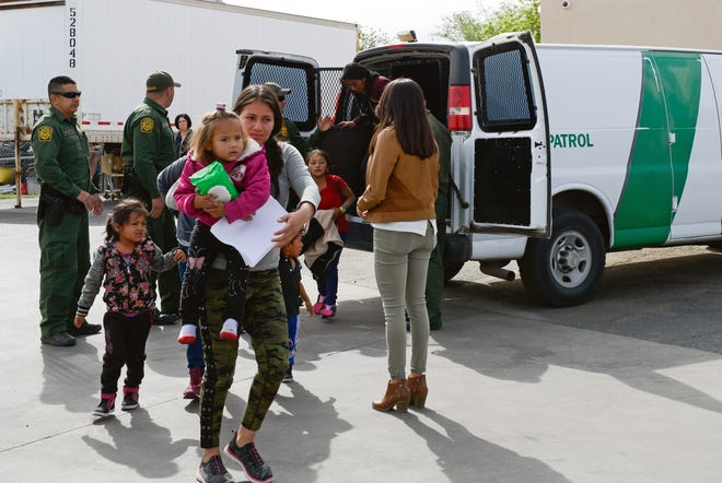 Migrants disembark from Border Patrol vans at the Gospel Rescue Mission in Las Cruces on Friday, April 12, 2019.
