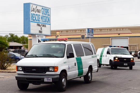 A second group of Border Patrol vans carrying migrants arrives at the Gospel Rescue Mission in Las Cruces on Friday morning, April 12, 2019.
