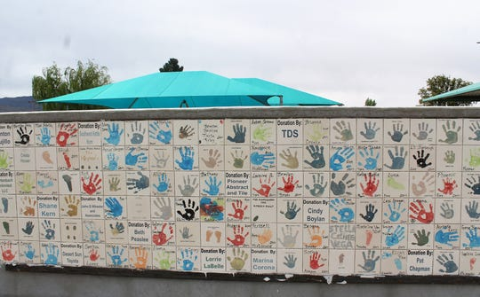 A portion of the handprint wall at Kids Zone park.