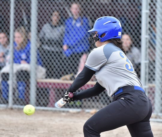 Marian's Julia Lucia makes contact with a Seaholm pitch.