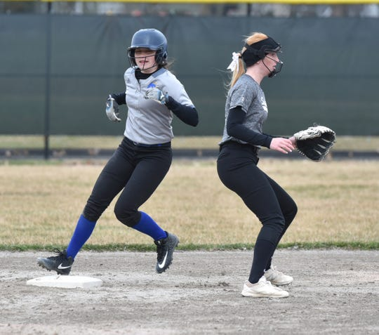 A Marian player stops short of second base after advancing on a hit during the first game at Seaholm.
