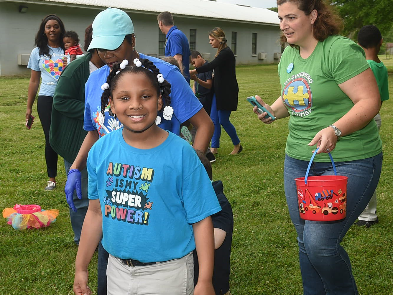 In conjunction with Autism Awareness Month in April, Grolee Elementary autistic students and parents engaged in fun activities which included and Easter egg hunt, beach balll games and bubble catching activities. The Easter Bunny was also there to take pictures with the students and their teachers.