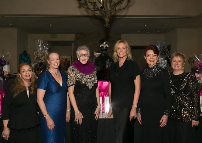 Pathfinders Vice President Ellen Scheuer (second from left) and President Bib Scott (fourth from left) with Casino de Paris Co-chairs (from left)Jacci Tutunjian, Marlene Lee, Christina Kelly and Becci Iamele.