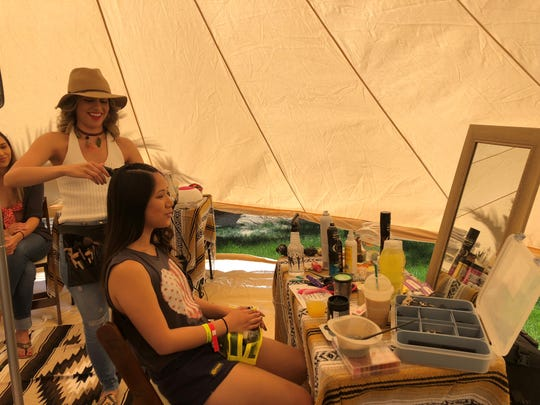 Melissa Lua of Indio styles the hair of Jessa Dejarme of Los Angeles in the hair and beauty tent at Rancho 51 Festival Campgrounds in Coachella, Calif., on Friday, April 12, 2019.