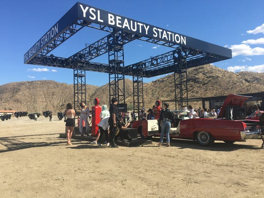 Visitors gather around a pop-up shop by the cosmetics company Yves Saint Laurent in Cathedral City, which is open during the first weekend of the Coachella Valley Music and Arts Festival.