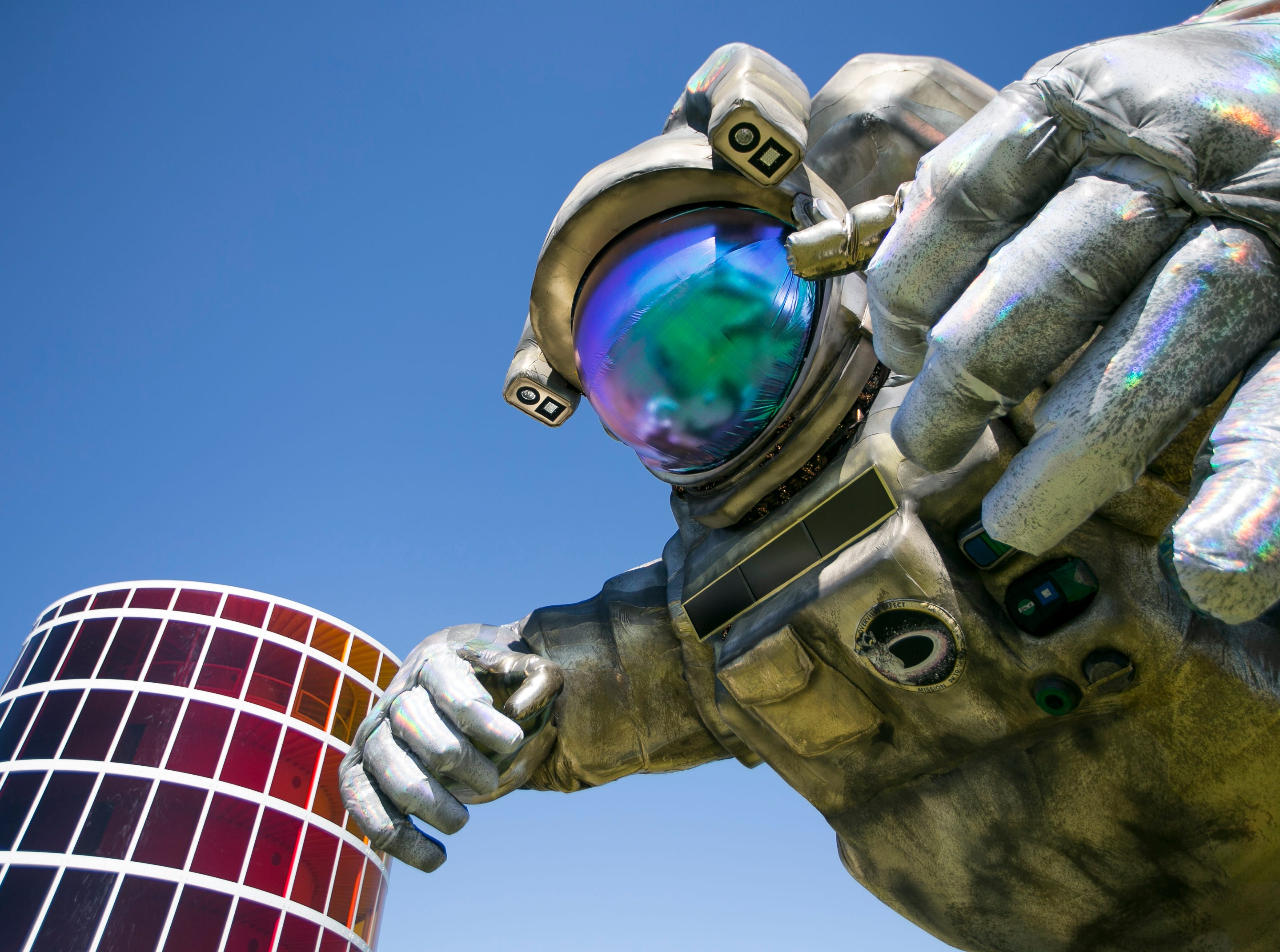 """Art installation the """"Overview Effect"""" astronaut by Poetic Kinetics looms at the Coachella Valley Music and Arts Festival in Indio, Calif. on Friday, April 12, 2019."""