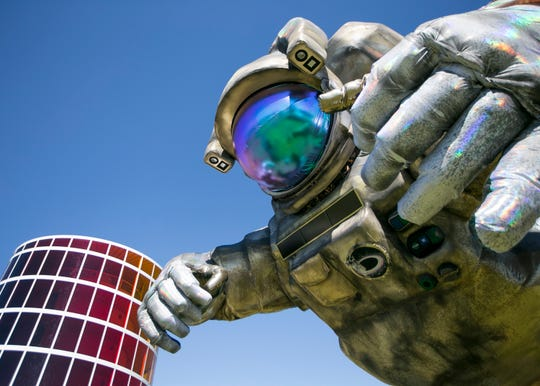 "Art installation the ""Overview Effect"" astronaut by Poetic Kinetics looms at the Coachella Valley Music and Arts Festival in Indio, Calif. on Friday, April 12, 2019."