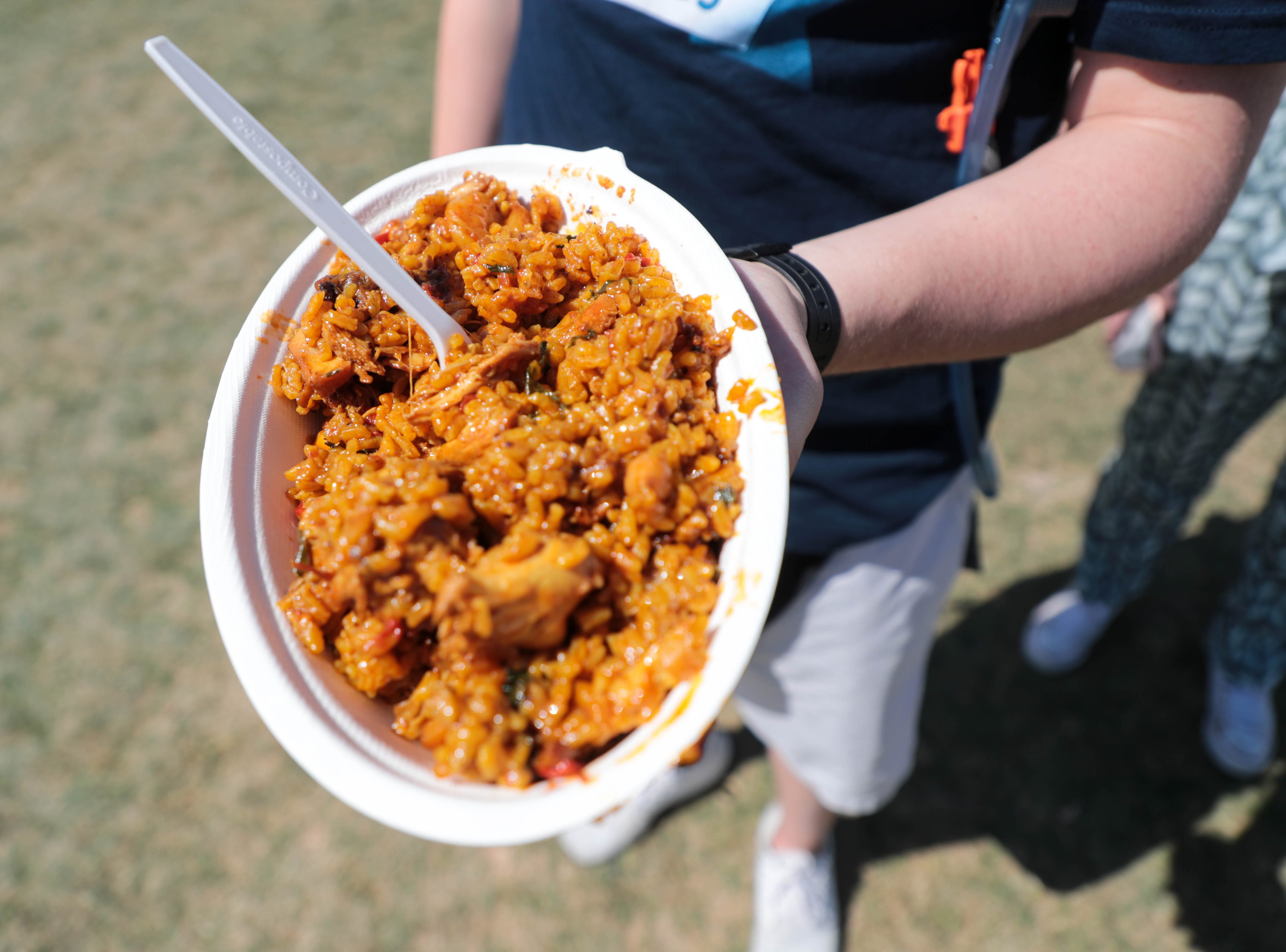 A man order paella at Coachella Valley Music and Arts Festival in Indio, Calif. on Friday, April 12, 2019.