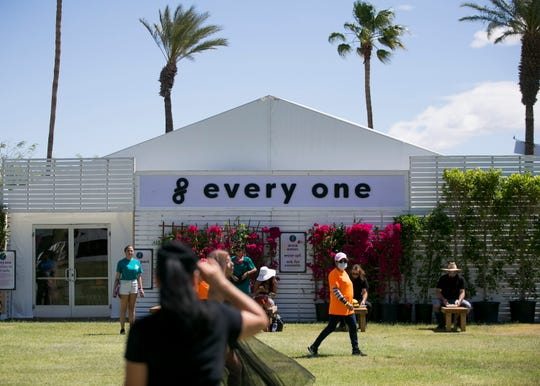 """Festival goers sit in front of the """"Every One"""" safe-space at the Coachella Valley Music and Arts Festival in Indio, Calif. on Fri. April 12, 2019."""
