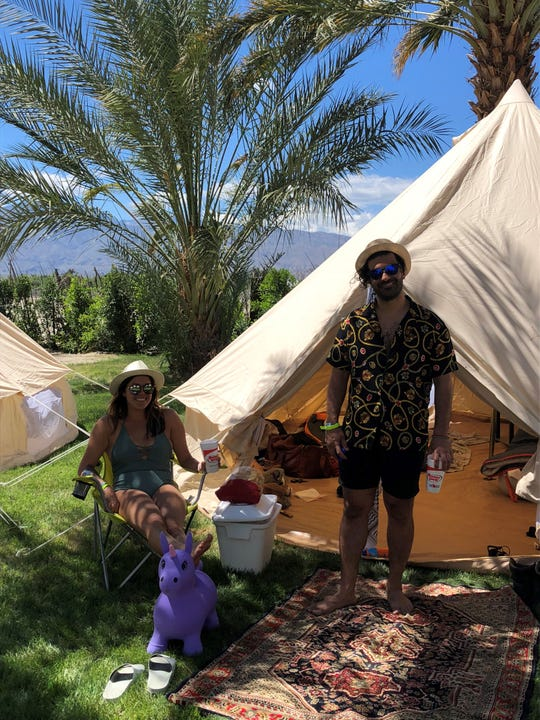 Natalia Castellino and Nima Gholamzadeh, both of San Diego, are staying at Rancho 51 Festival Campgrounds in Coachella during the Coachella Valley Music and Arts Festival on Friday, April 12, 2019.