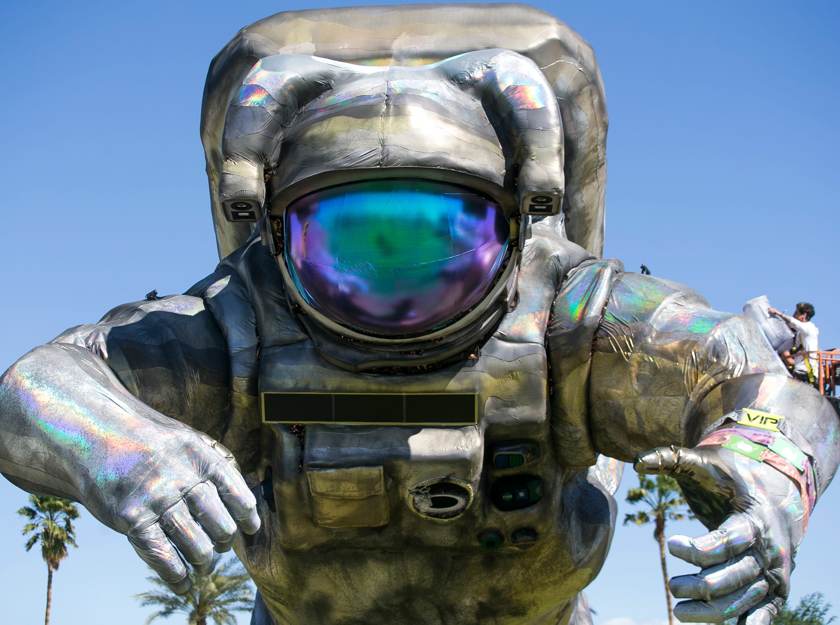 """Art installation the """"Overview Effect"""" astronaut by Poetic Kinetics looms at the Coachella Valley Music and Arts Festival in Indio, Calif. on Fri. April 12, 2019."""