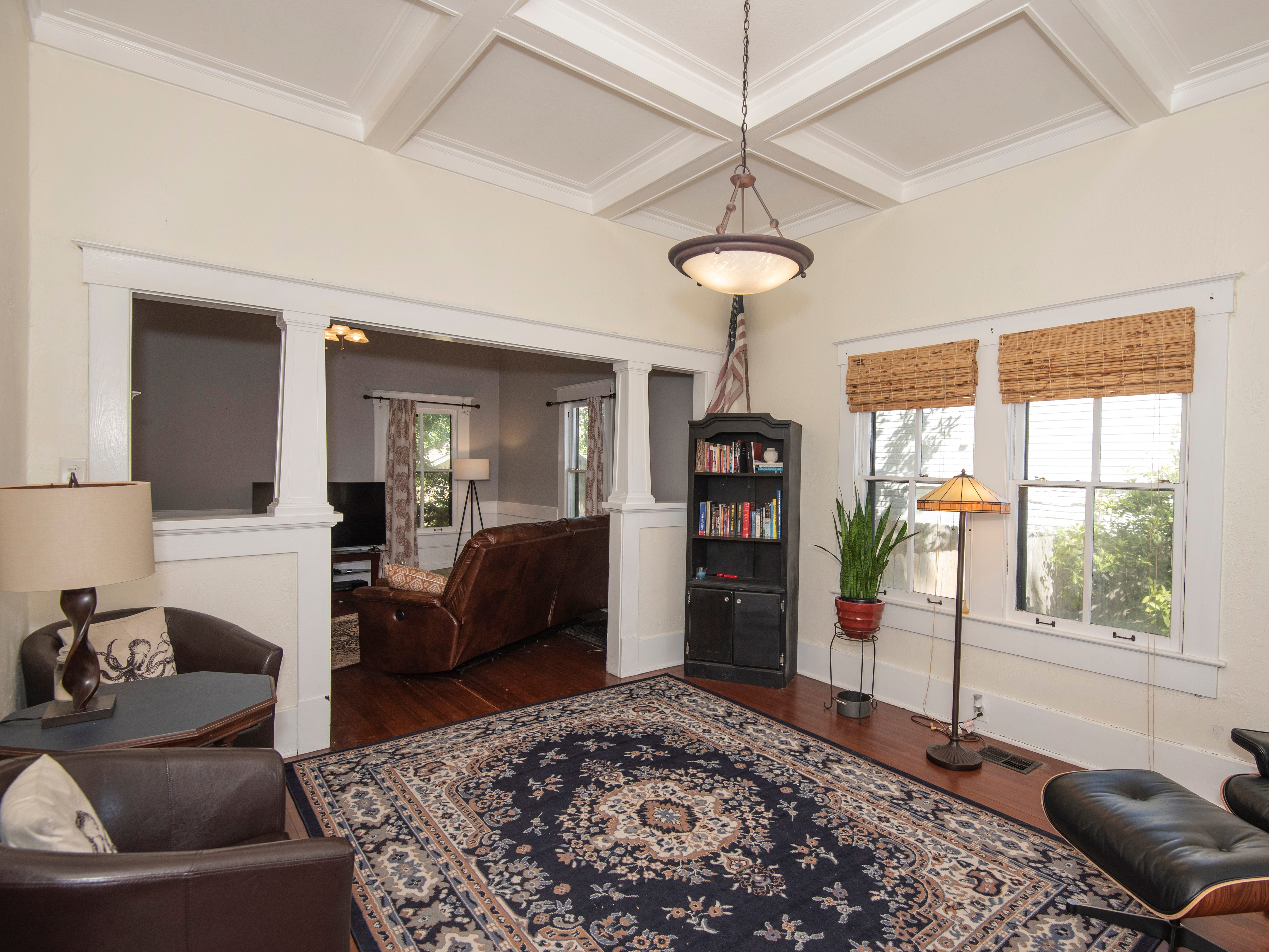 """A charming home at 713 N. 15th Ave. in East Hill has both character and history. Constructed in 1906, the house has recently had upgrades to the foundation, bringing it into the 21st century with a """"high-tech smart jack system"""" and a 25-year warranty."""