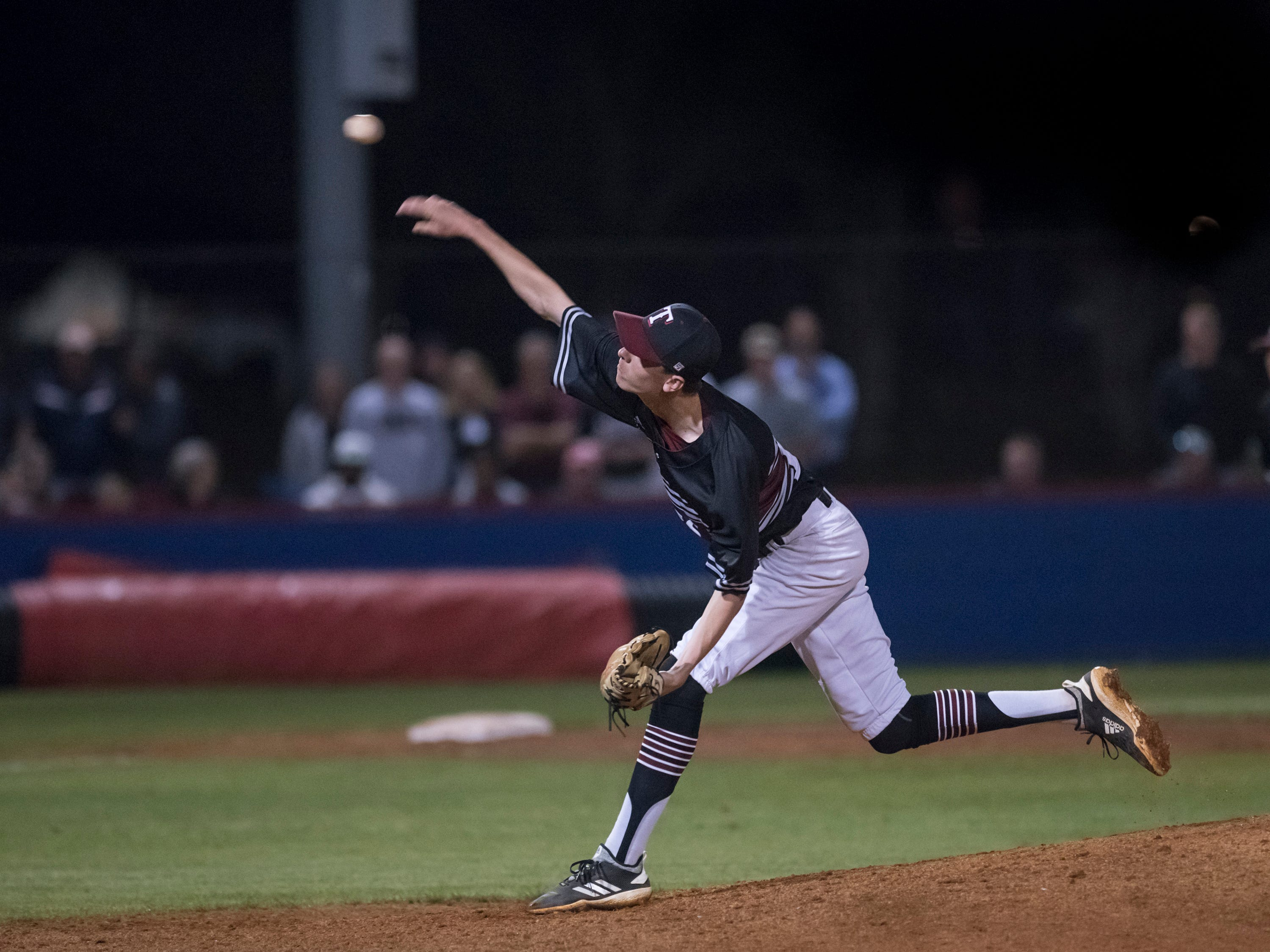 Jace Dunsford (21) pitches during the Tate vs Pace baseball game at Pace High School on Thursday, April 11, 2019.
