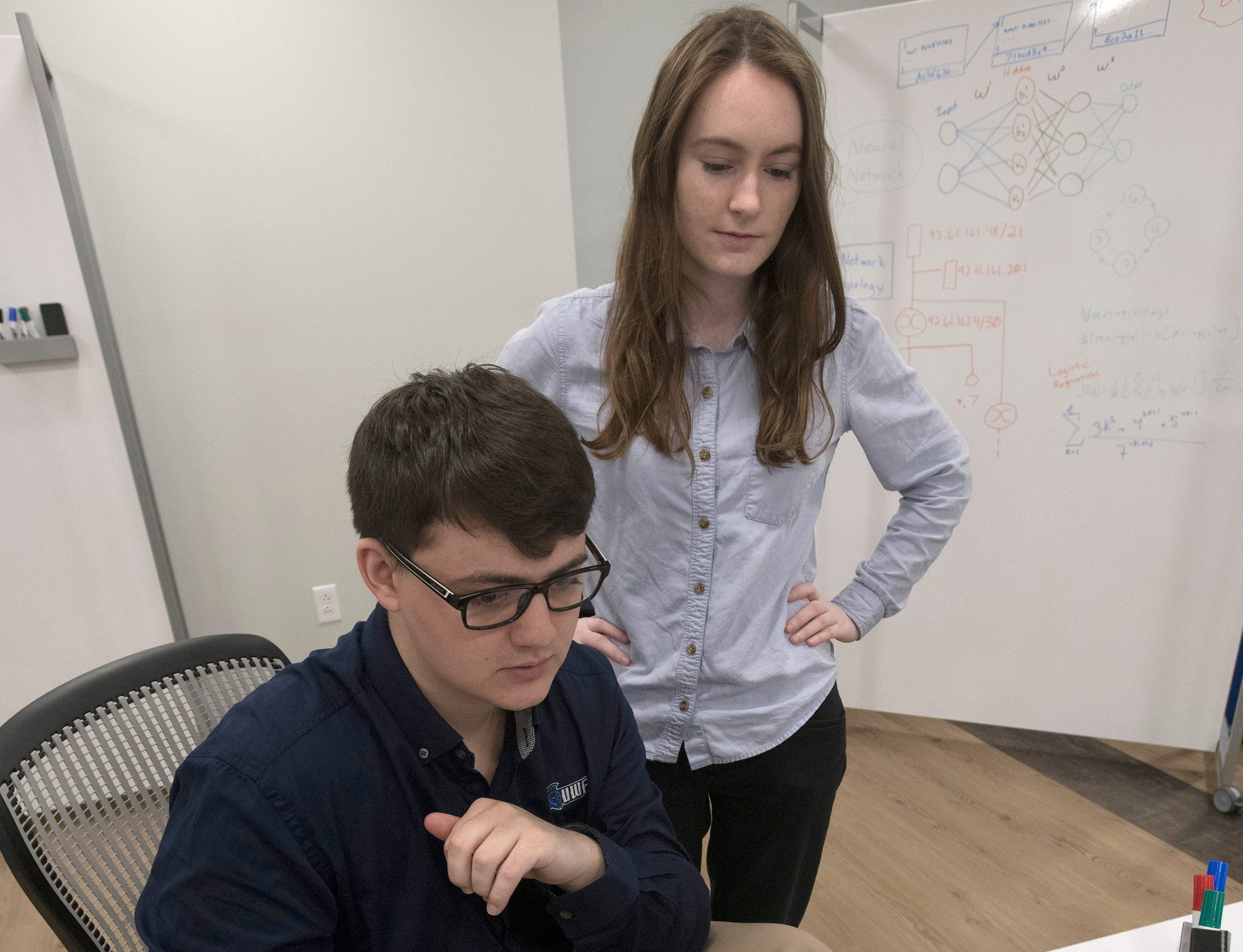 University of West Florida cybersecurity ambassadors Carson Wilber and Ashley Runwick begin working out of the new Center for Cybersecurity in downtown Pensacola on Friday, April 12, 2019. Located in the Studer Community Institute building the new UWF center will increase the university's presence in downtown Pensacola.