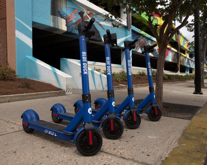 Blue Duck scooters are popping up in downtown Pensacola on Friday, April 12, 2019.