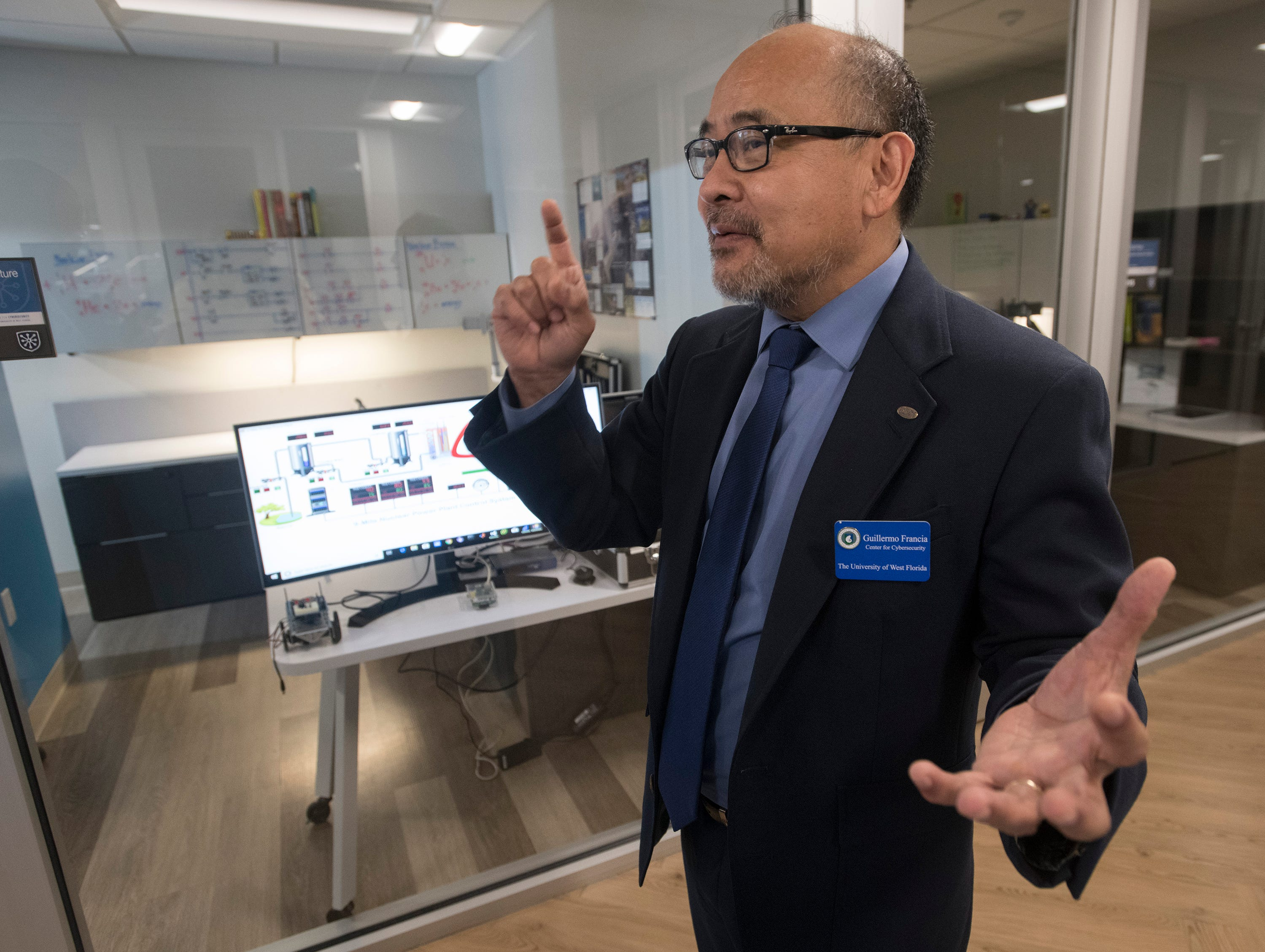 Guillermo Francia describes the need for cybersecurity professionals to protect critical infrastructure during a tour of the new Center for Cybersecurity on Friday, April 12, 2019. Located in the Studer Community Institute building the new  UWF center will increase the university's presence in downtown Pensacola.