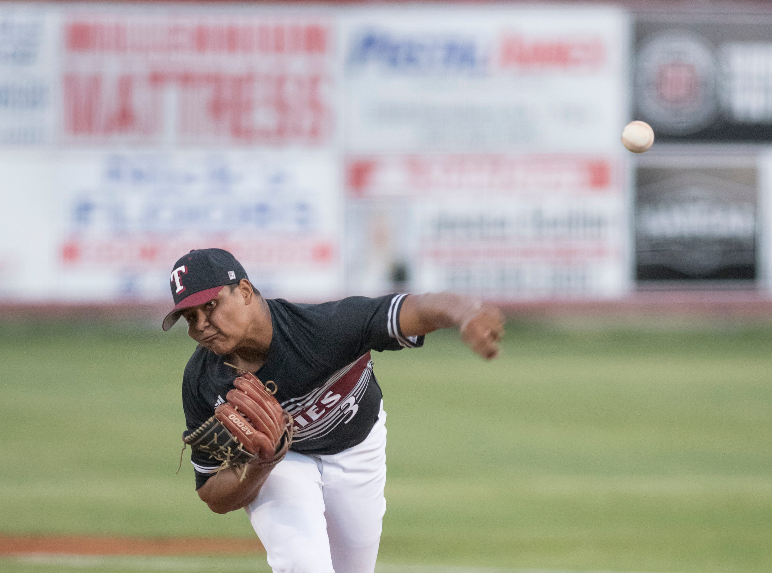 Starter Darrien McDowell (3) pitches during the Tate vs Pace baseball game at Pace High School on Thursday, April 11, 2019.