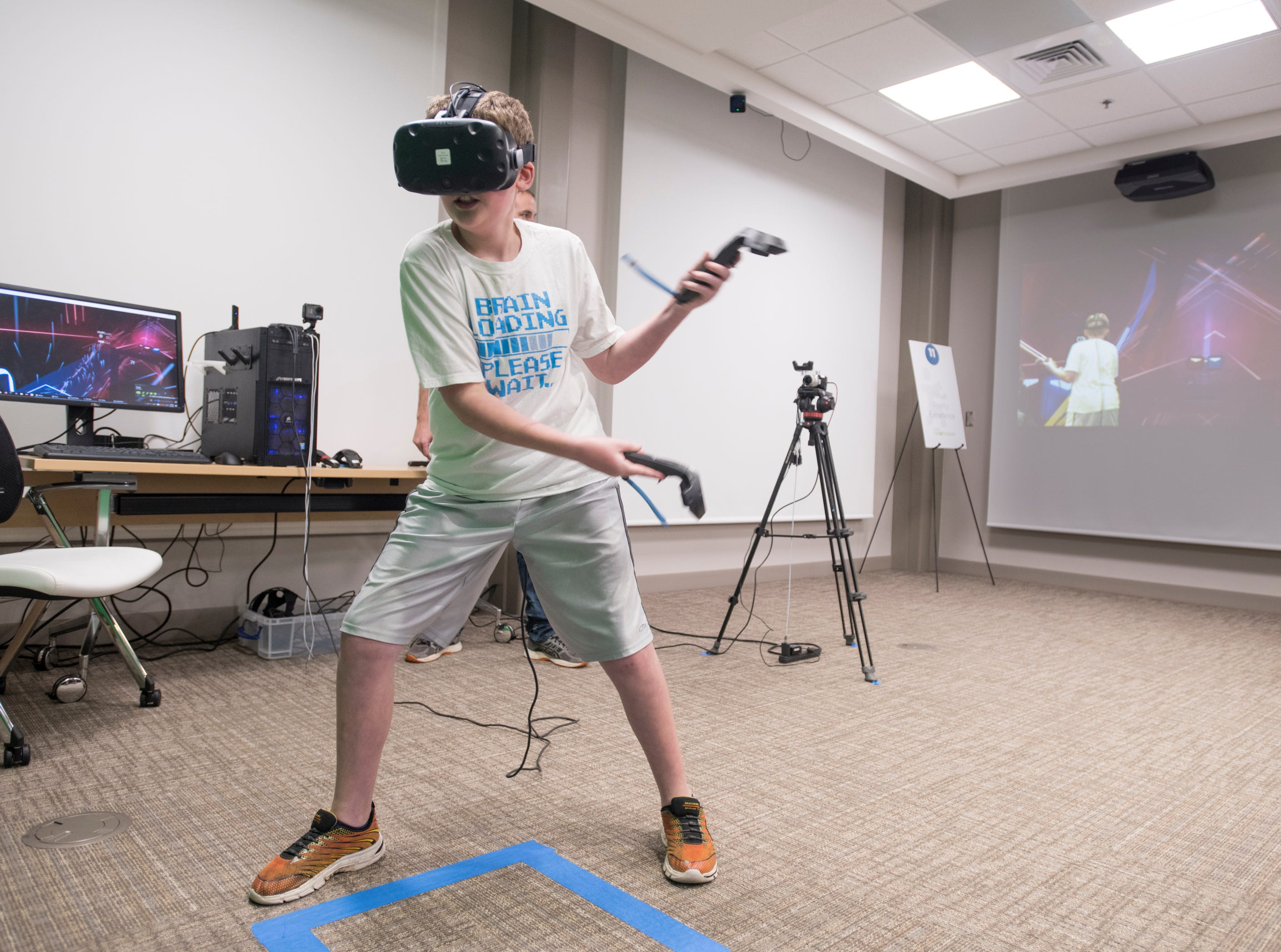 Dane Bullock, 12, tries out a virtual reality video game during the IHMC Open House in downtown Pensacola on Friday, April 12, 2019.