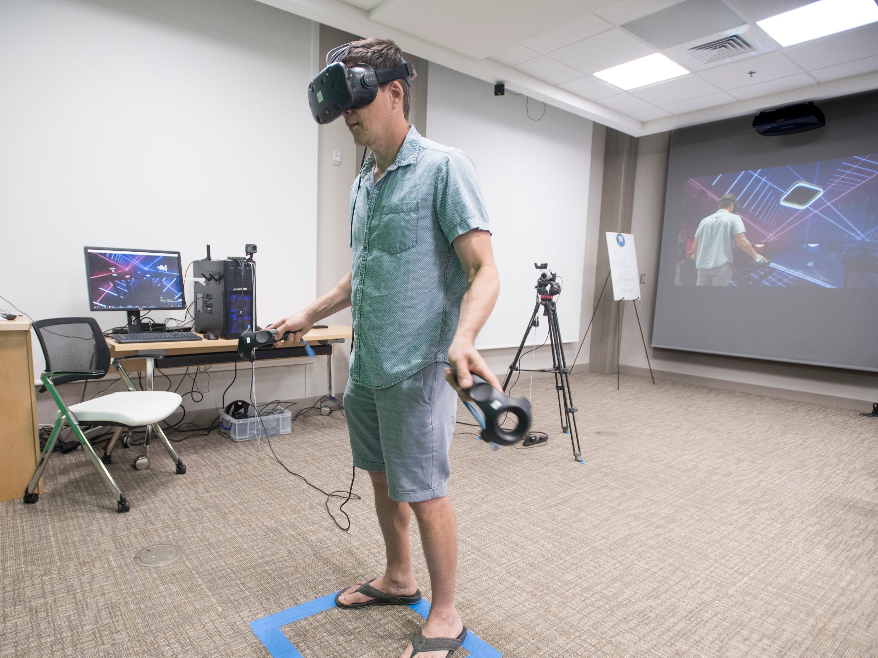 Noah Butler tries out a virtual reality video game during the IHMC Open House in downtown Pensacola on Friday, April 12, 2019.