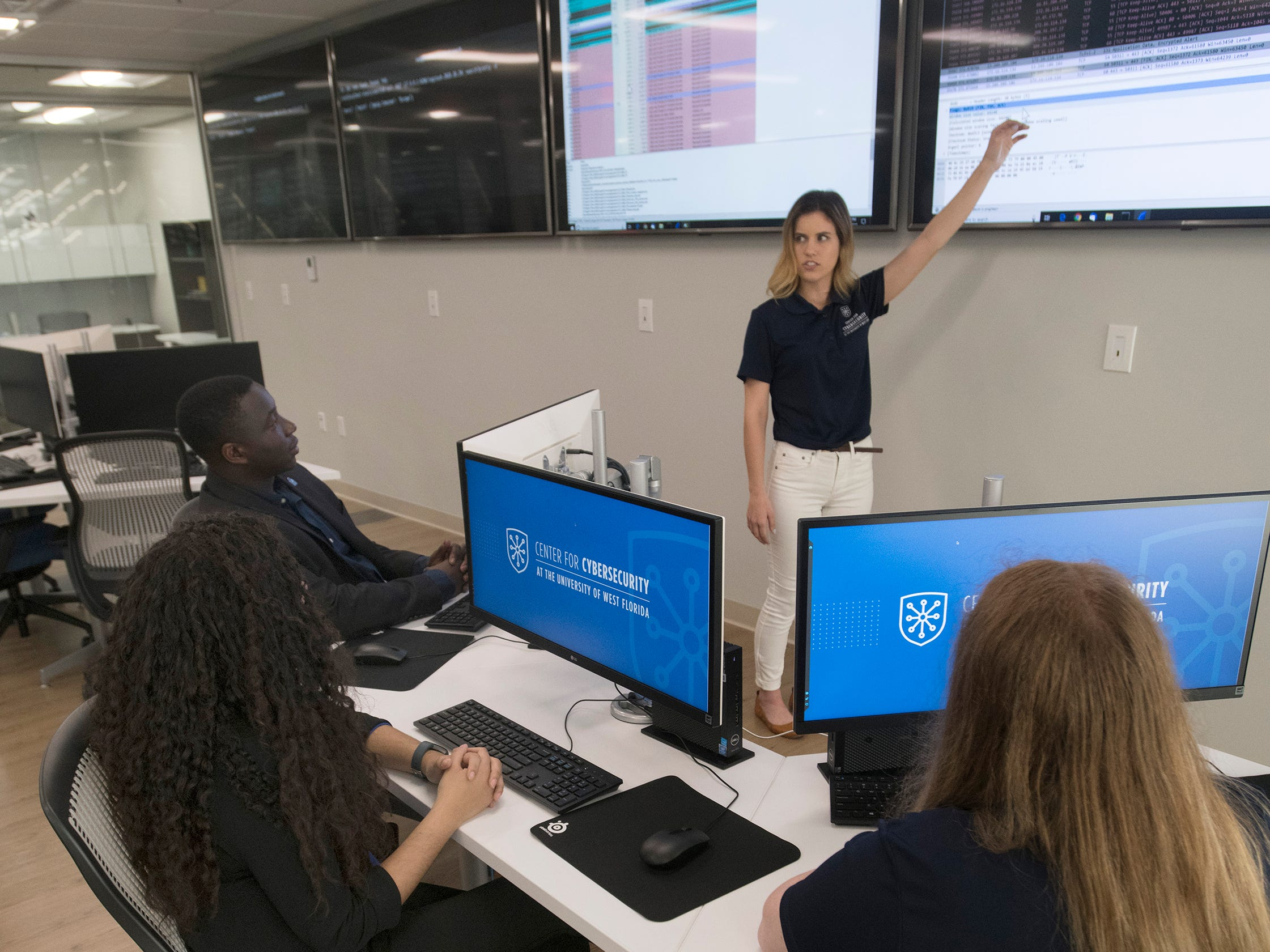 University of West Florida cybersecurity ambassadors begin working out of the new Center for Cybersecurity in downtown Pensacola on Friday, April 12, 2019.  Located in the Studer Community Institute building the new UWF center will increase the university's presence in downtown Pensacola.