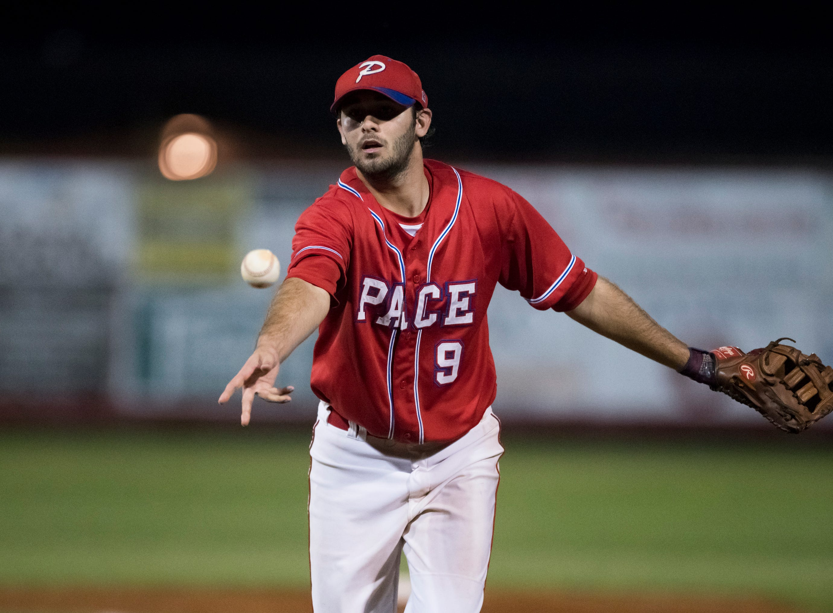 First baseman Dalton Dean (9) tosses to first for an out during the Tate vs Pace baseball game at Pace High School on Thursday, April 11, 2019.