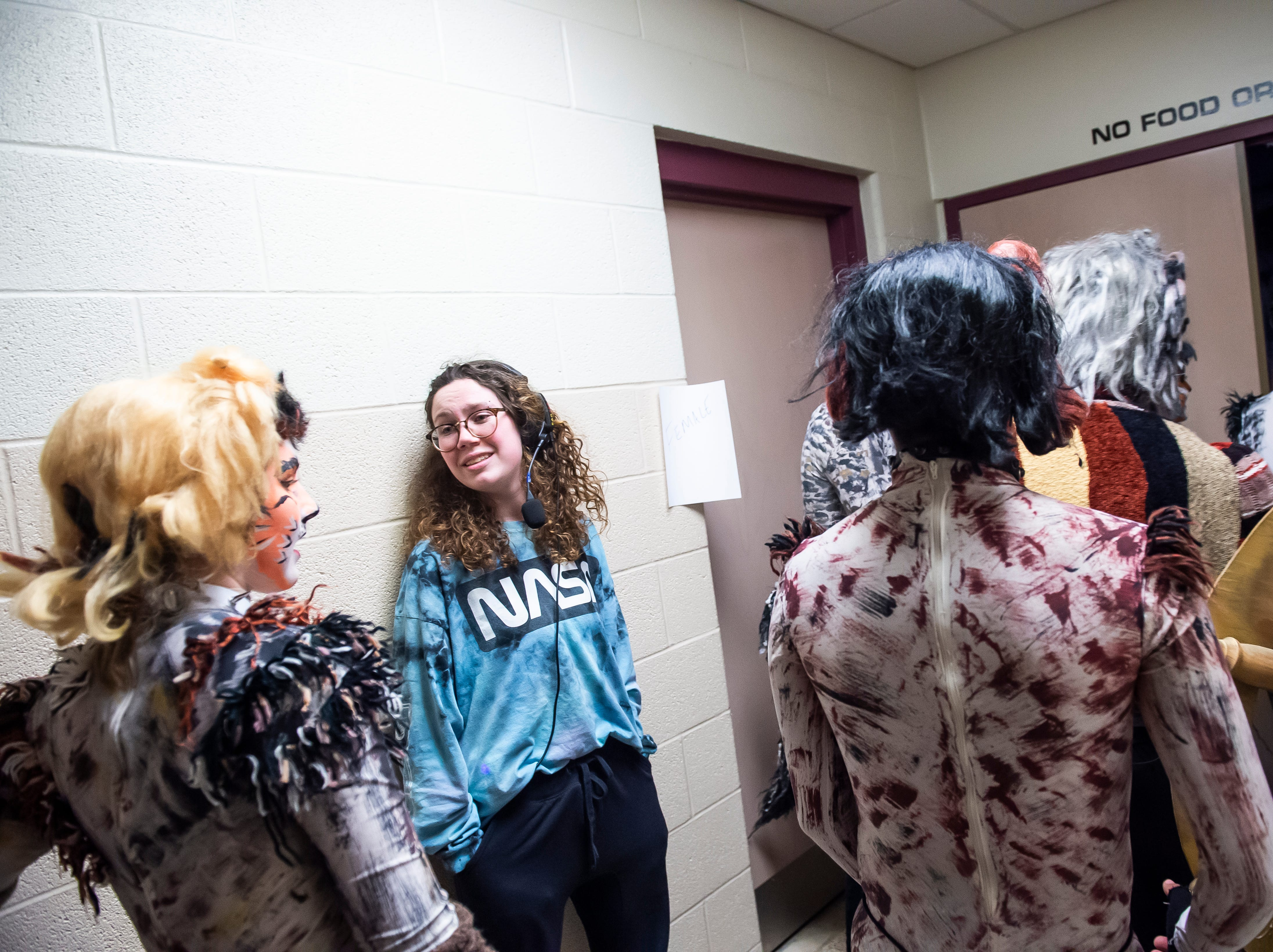 """Hanover High School students head back on stage for the start of the second act of a dress rehearsal for their production of the musical """"Cats"""" on Wednesday, April 10, 2019."""