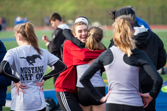 A South Western athlete gets a hug after competing during a track and field meet against Spring Grove on Thursday, April 11, 2019.