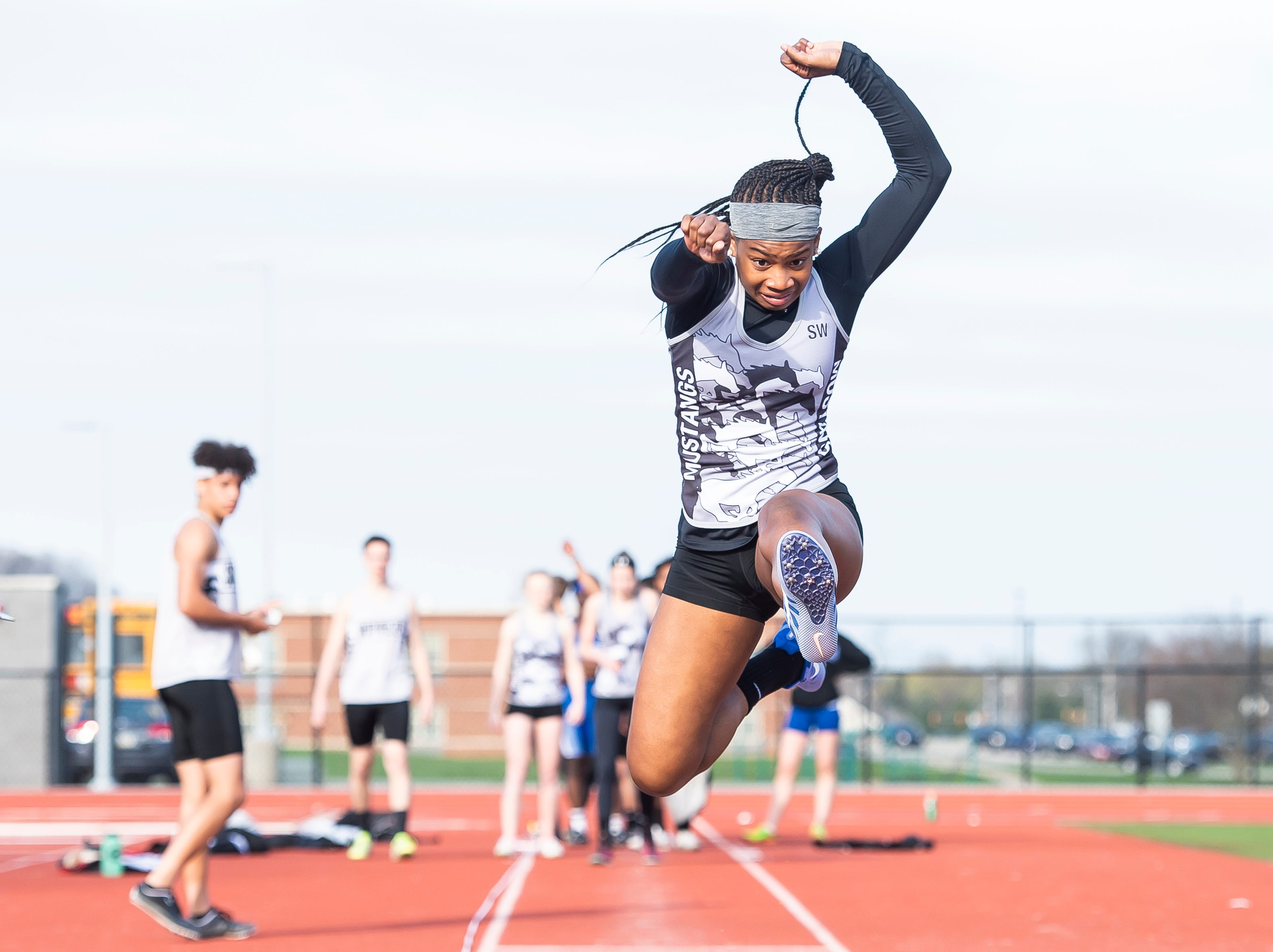 South Western's Zaiyah Marshall competes in the triple jump during a track and field meet against Spring Grove on Thursday, April 11, 2019.