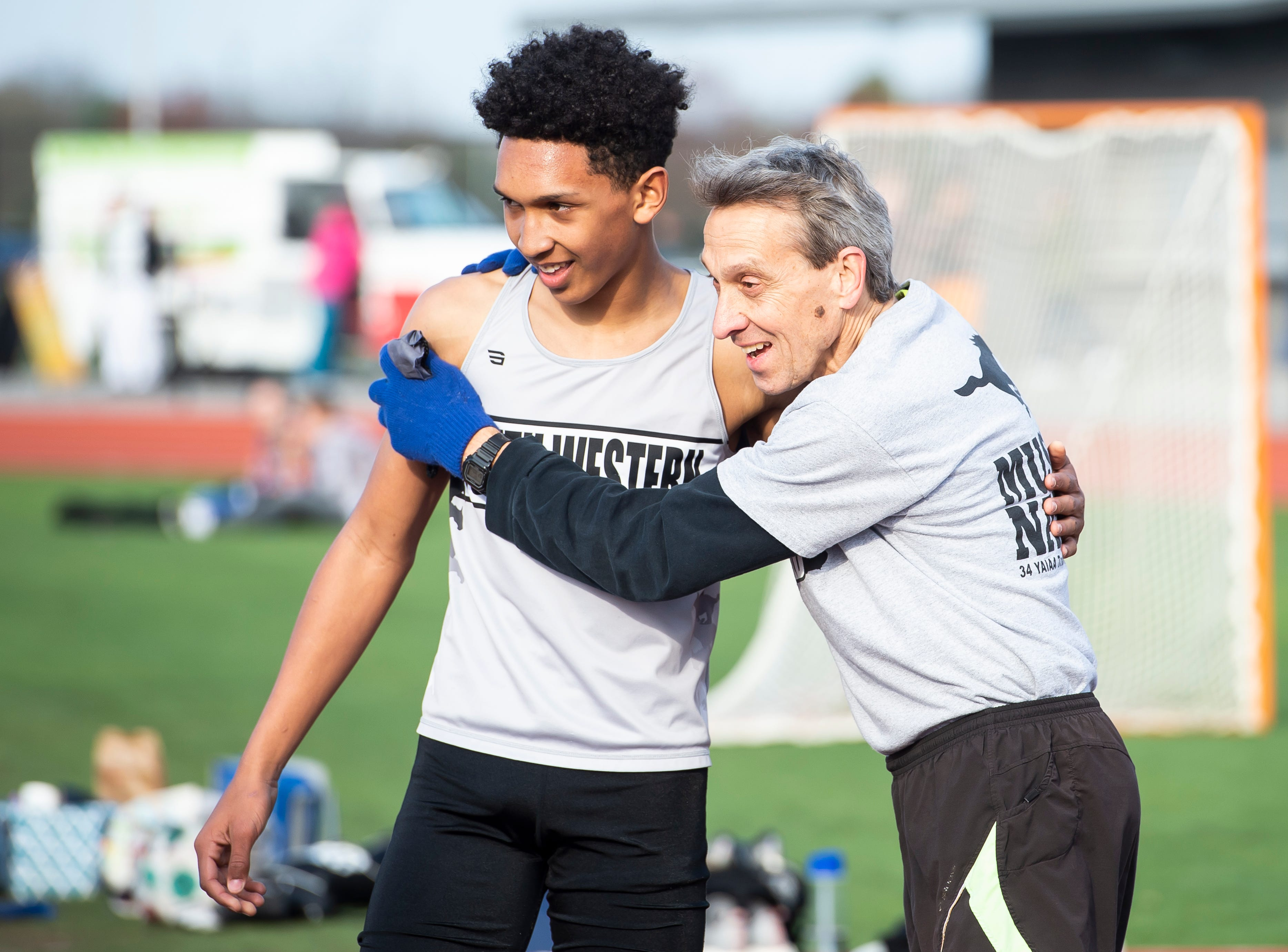 South Western' Shilo Bivins gets a hug from coach Pete Dodd after placing third in the 800m during a track and field meet against Spring Grove on Thursday, April 11, 2019.